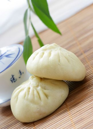plateful: Chinese pasty and tea cup close-up