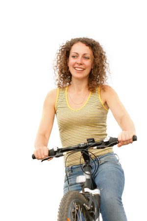 Pretty woman on a bicycle isolated over a white background photo