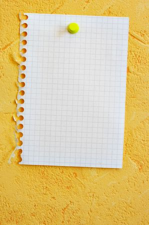 Single blank sheet attached to a yellow wall photo