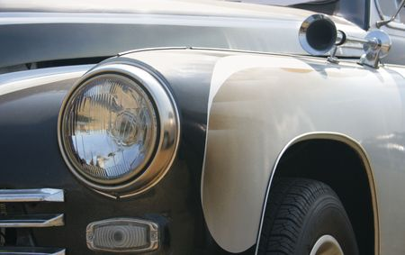 tune: Classic and vintage cars - headlight and klaxon close-up 1950s