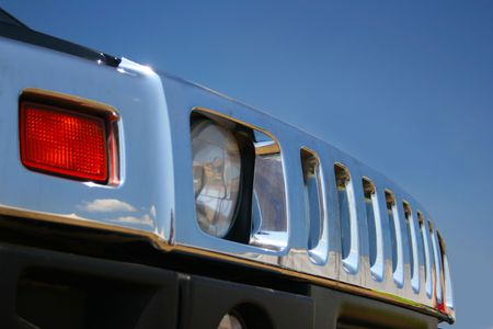 enclosure: Off-road car radiator enclosure close-up against a blue sky