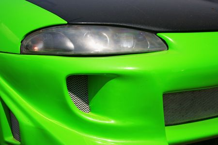 Green car front - radiator and headlight close-up Stock Photo - 1268061