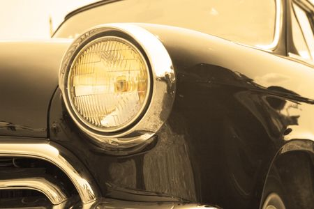 Classic and vintage cars - headlight close-up toned in sepia Stock Photo - 1296937