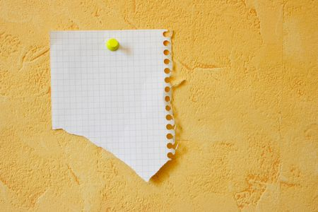 bulletinboard: Lacerated blank sheet attached to a yellow wall