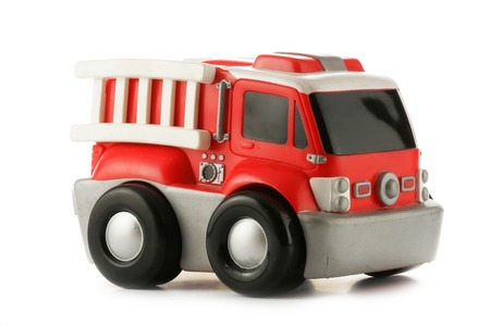 antique fire truck: Red fire engine toy isolated over a white background