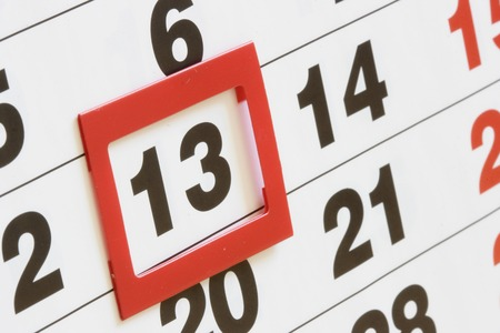 Sheet of calendar with red mark on Friday, 13 Stock Photo