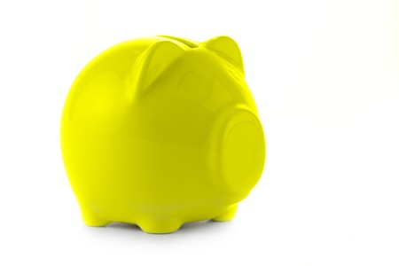Yellow piggy bank isolated over a white background photo