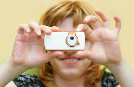 Happy smiling girl take a photo per cell phone Stock Photo - 1576902