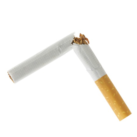 Broken cigarette isolated over a white background photo