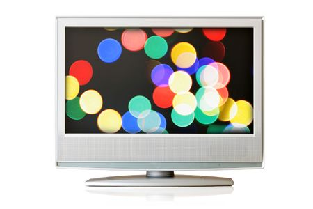 Flat LCD TV isolated with colorful christmas lights oo screen over white background photo