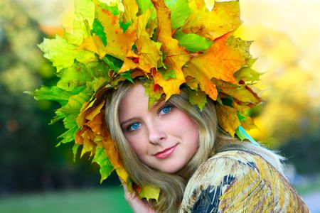 beatitude: Miss Autumn. Beautiful blue-eyed woman with diadem made from yellow maple leaves