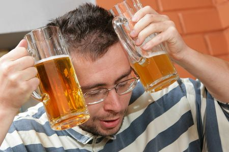 Man to have a hang-over in a pub photo