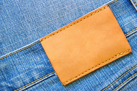 Blue jeans with blank leather label for your own text photo