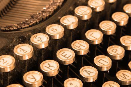 Keyboard of vintage typewriter close-up toned in sepia photo