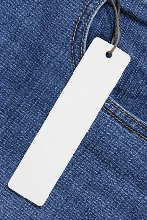 Price tag over jeans background, place your own text here photo