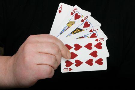 suited up: Royal flush - highest poker hand over dark background