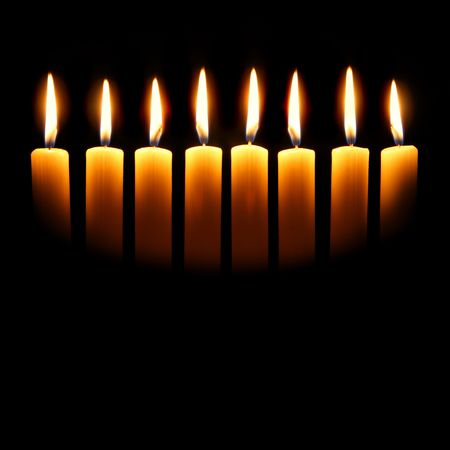 hanuka: Channukah candles over black background with space for your text