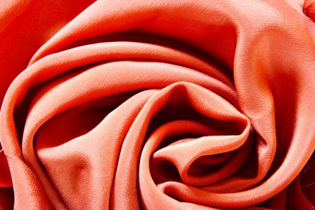 Silk rose - fabric background with deep folds photo