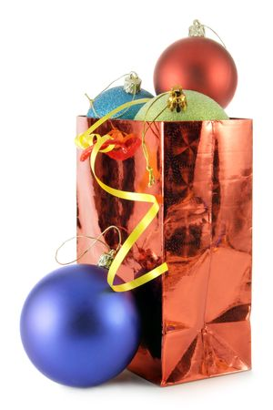 bedeck: Small bag with colorful Christmas balls isolated over white background