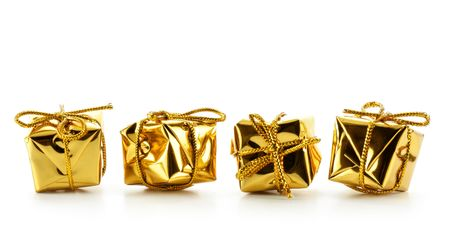 bedeck: Four golden boxes isolated over white background