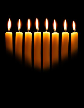 Channukah candles over black background with space for your text photo