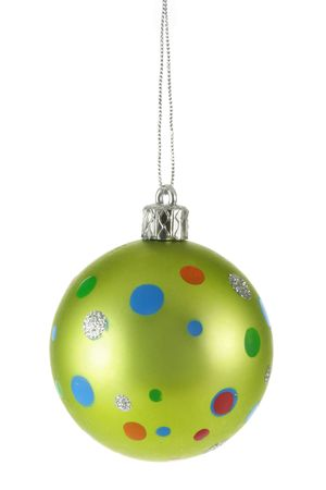 bedeck: Light-green Christmas ball with colorful spots isolated over white background Stock Photo