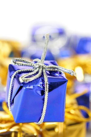 Blue gift box close-up and other boxes in the background out of focus photo