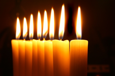 chanukkah: Eight burning candles over black background Stock Photo