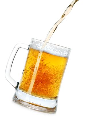 beer tap: Pouring beer into mug isolated over a white background