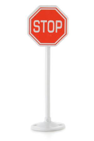 plactic: Toy road sign STOP isolated over white background Stock Photo