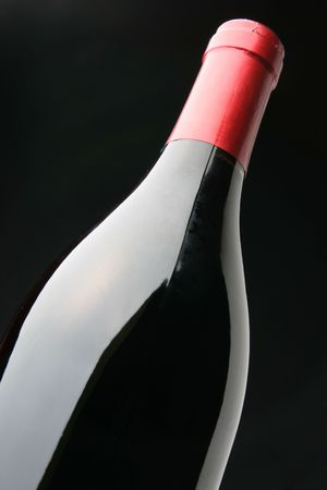 corked: Single corked bottle of red wine over black background