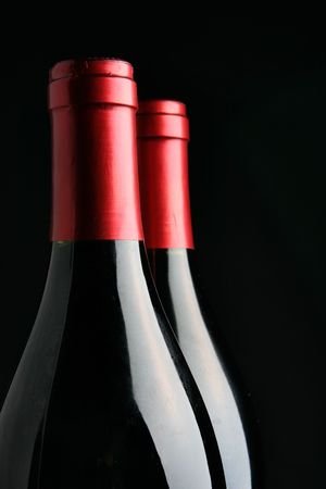 Two corked wine bottles over black background Stock Photo - 2357783
