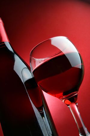 Still-life with bottle and glass of wine over red background Stock Photo - 2407592