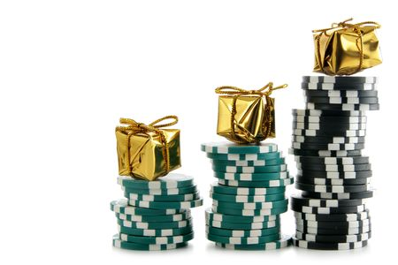 Stacks of casino chips with golden boxes on the top isolated over white background photo