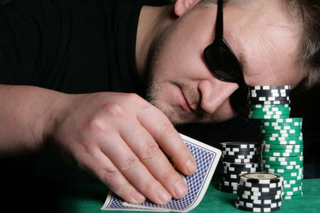 Poker gambler and casino chips close-up photo
