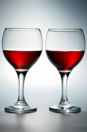 Still-life with two glasses of red wine photo