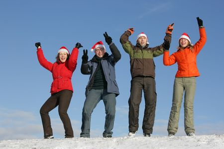Friends with Santa hats have fun on flank of hill Stock Photo - 2481867