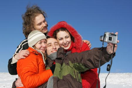 Four friends taking a selfportrait in winter Stock Photo - 2481896