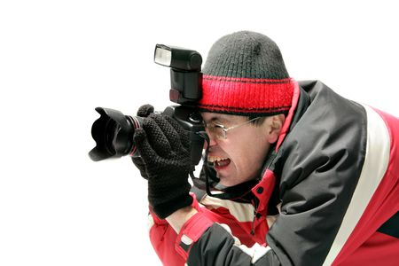 Professional photographer taking a shot isolated over white background Stock Photo - 2481869