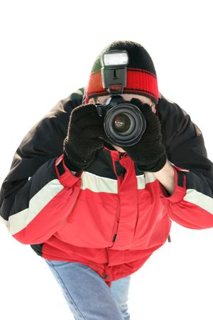 Professional photographer taking a shot isolated over white background. Focus on the lens. Stock Photo - 2481804