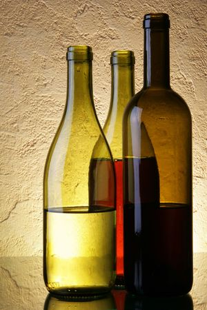 Still-life with three wine bottles over textured background Stock Photo - 2546461