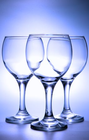 bocal: Three empty footed glasses toned in blue color