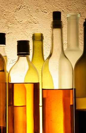 taster: Still life with alcoholic beverages over textured background Stock Photo