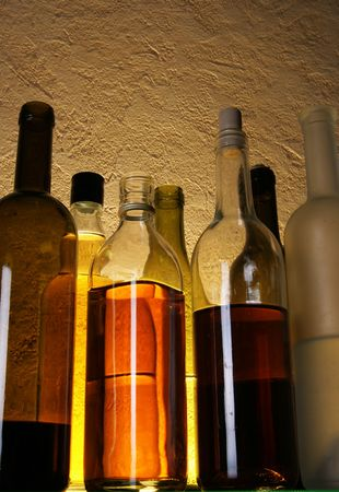 Still life with alcoholic drinks over yellow background photo