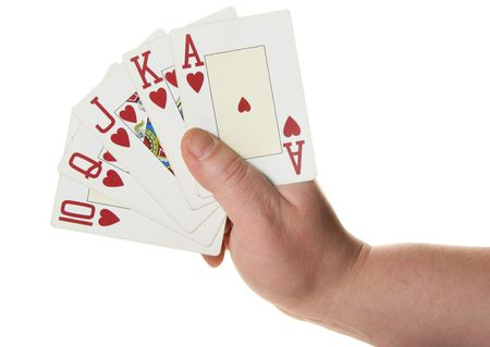 suited up: Royal flush - highest poker hand isolated over white background Stock Photo