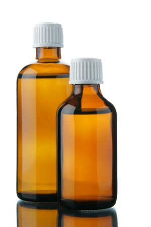 linctus: Two small bottles with medicinal solution isolated over white background Stock Photo