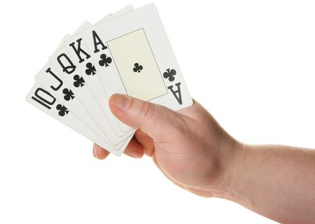 suited up: Hand holding Royal flush - highest poker hand isolated over white background