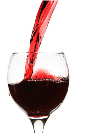 Red wine pour into glass close-up isolated over white background Stock Photo - 2698935