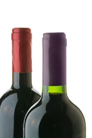 Two wine bottles close-up isolated over white background photo