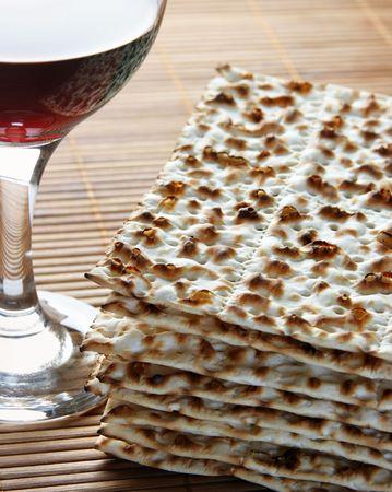 Wine and matzoh - elements of jewish passover supper photo